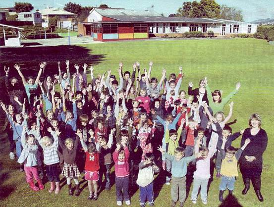 Hands-up: Students and teachers of Liberton Christian School in Dunedin.