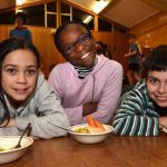 Liberton Christian School pupils (from left) Bethany Pantel (9), Malaika Ogebuehi (10) and Daniel Bretz (10) enjoy lentil dahl, carrots and rice - the type of food Syrian refugees might eat at refugee camps in Jordan. Photo by Gregor Richardson